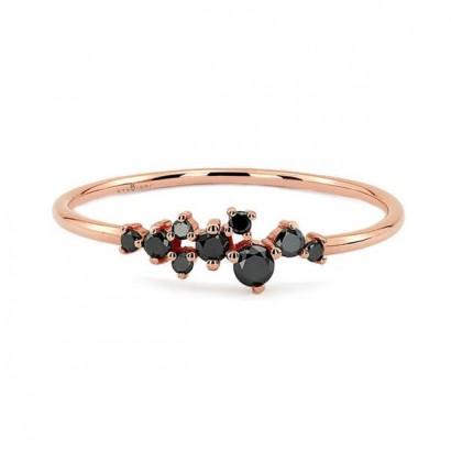 14CT ROSE GOLD BLACK DIAMOND RING.